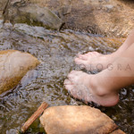 bare feet in a stream